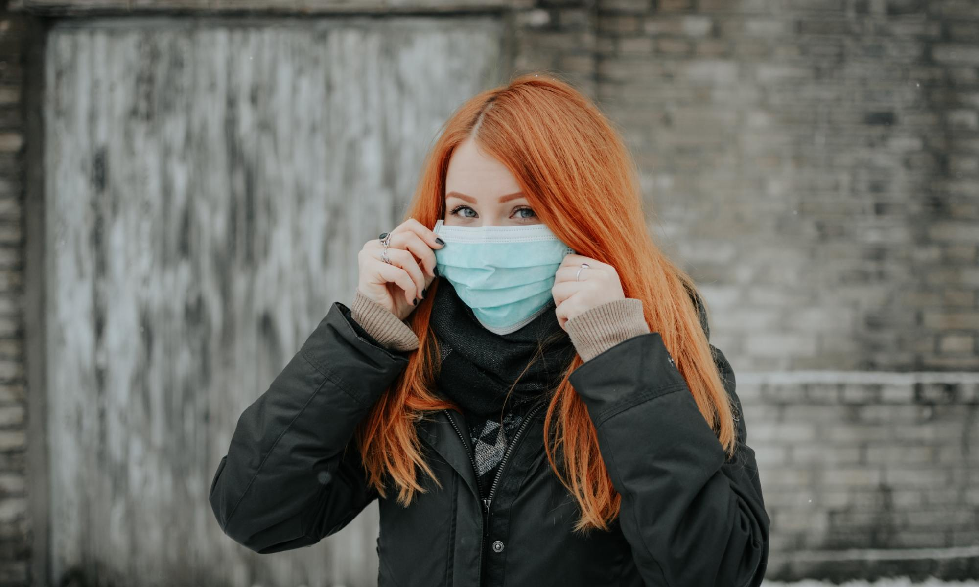 Coronavirus Pandemic Outbreak a woman wearing a face mask