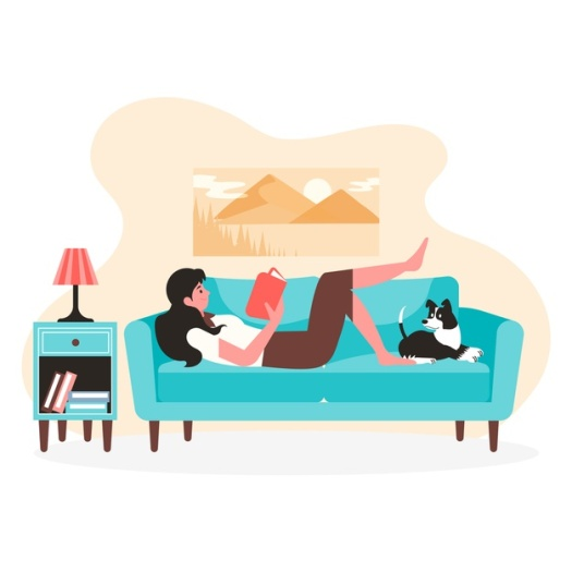 Woman reading a book and relaxing with her dog